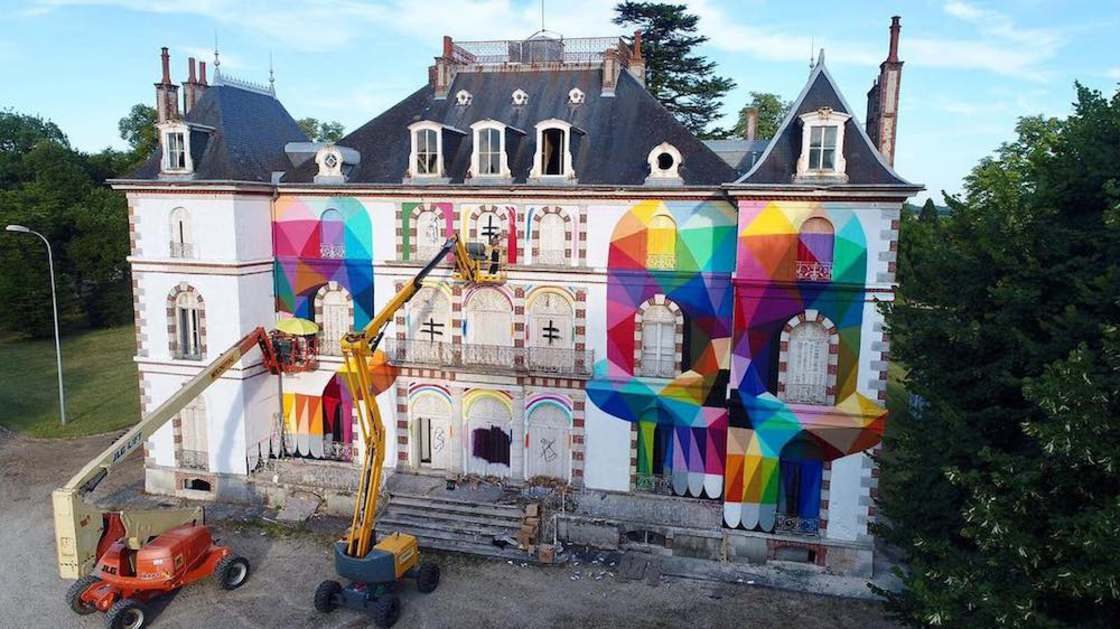 Street Art - Okuda paints colorful skulls on an abandoned castle