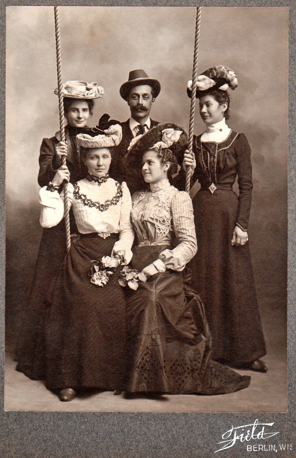 Man with four women, Berlin, Wisconsin.jpg