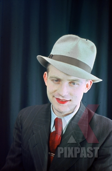 stock-photo-young-austrian-man-in-american-style-20s-hat-and-jacket-with-red-lipstick-theatre-show-1937-later-becomes-war-reporter-8979.jpg