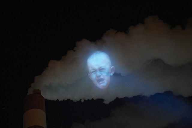 Faces Projected on Air Pollution Smoke