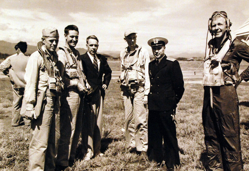 Several U.S. Navy pilots greet members of the Soviet Legation at Atsugi airfield near Tokyo, 28 August 1945. The pilots had landed the first U.S. combat aircraft there shortly before. Those present are (left to right) - Lieutenant Commander John N. MacInnes; Lieutenant Commander Don Thorburn; K. Samiloff, of the Soviet Legation; Lieutenant W.V. Ballew; Commander Anatoliy Rodinov, Soviet Navy and Lieutenant Commander E.V. Wedell.