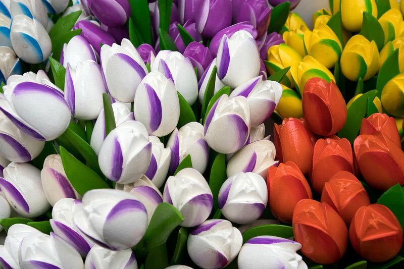 the Souvenirs at Bloemenmarkt - floating flower market on Singel Canal. Amsterdam. Netherlands