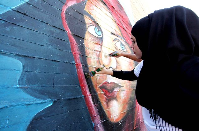 Palestinian art students take part in a festival marking the World Mental Health Day on October 11,