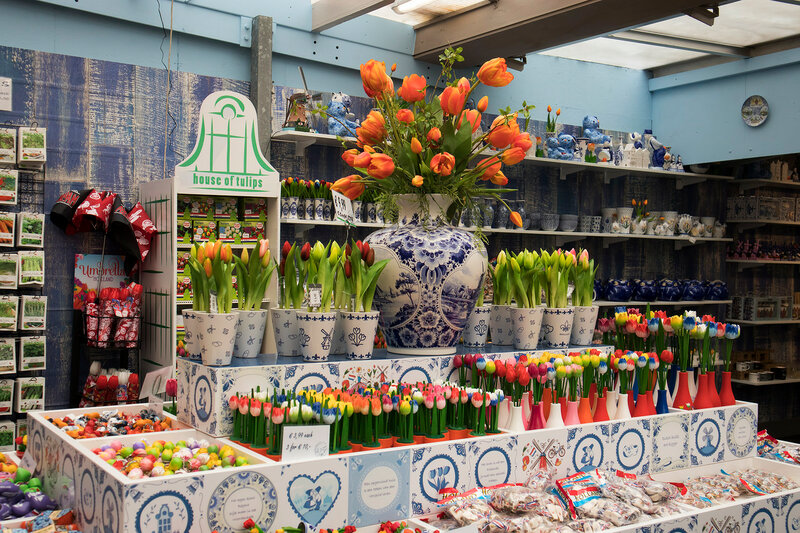 Showcases of Dutch shops with blue typical dishes