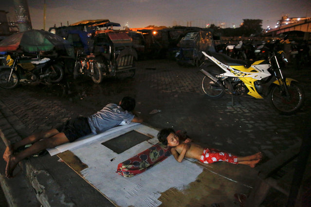 People sleep in open air in Tondo, Manila, Philippines early October 18, 2016. (Photo by Damir Sagol