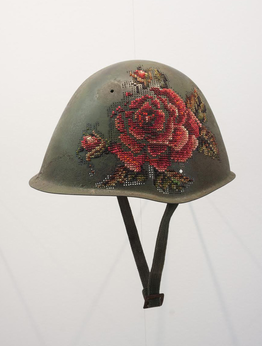 Floral Elements Embroidered Directly on Antique Soldiers' Helmets (10 pics)