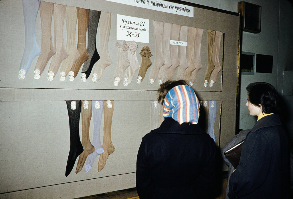Russia, women looking at hosiery display at store in Moscow