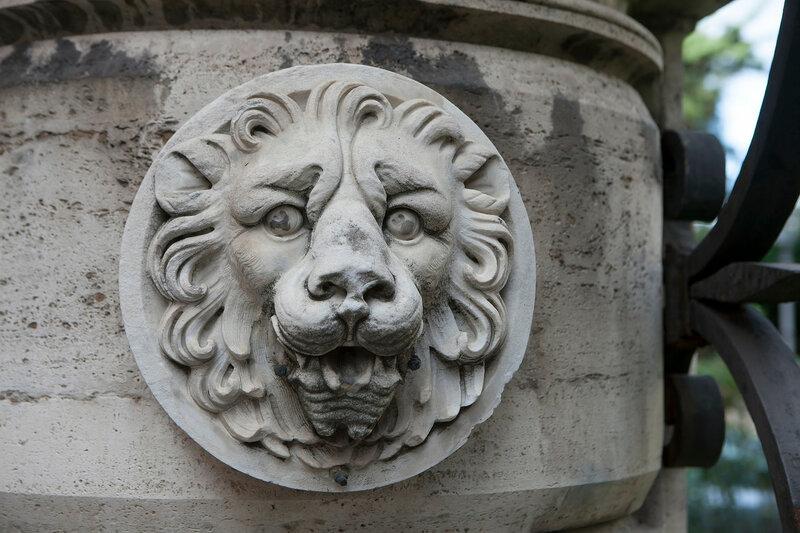 Stone sculpture lions head on ancient Roman building