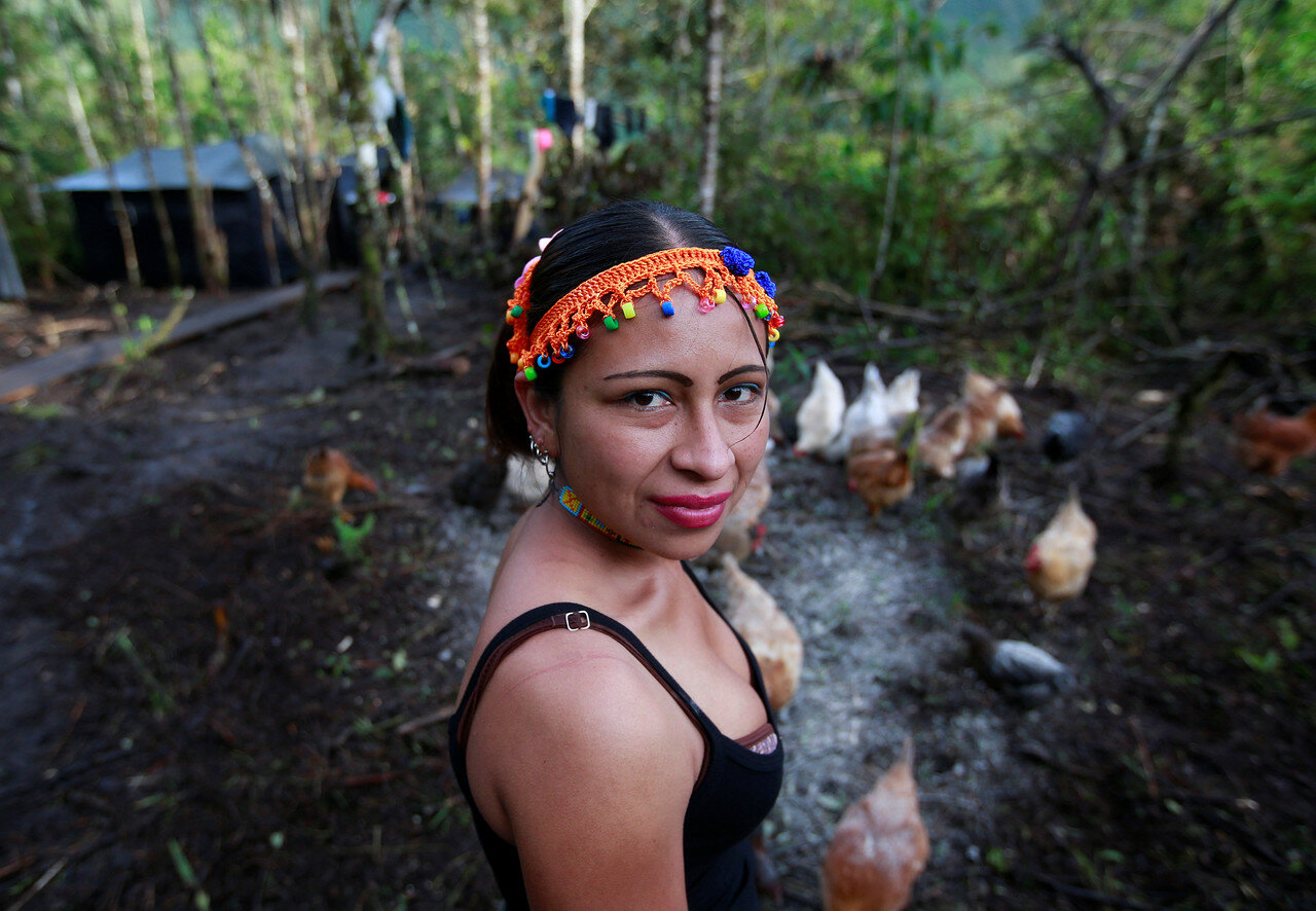 Patricia, a member of the 51st Front of the Revolutionary Armed Forces of Colombia (FARC), poses for a picture at a camp in Cordillera Oriental