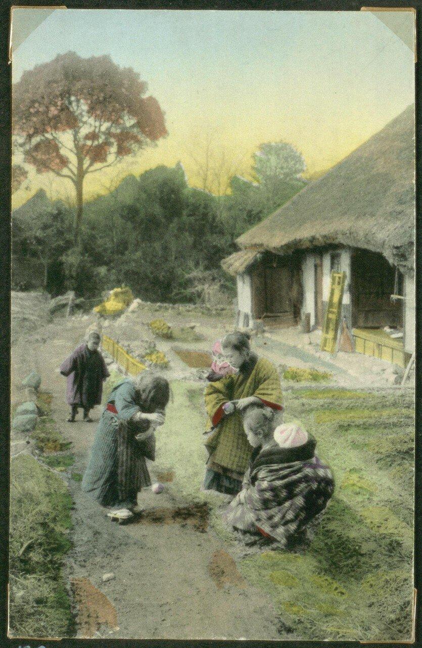 Женщина и дети в деревне
