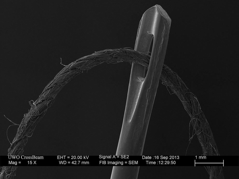 13. Край лезвия бритвы, 10000-кратное увеличение.