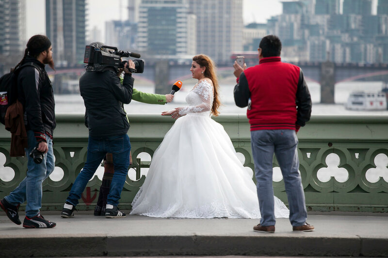 The bride is giving an interview on the bridge near Westminster. After the terrorist attack