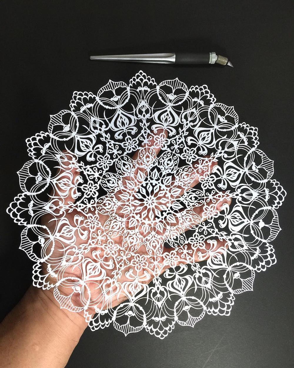 All images via @mr_riu Japanese artist Mr. Riu takes paper cutting to an intricate extreme, craftin