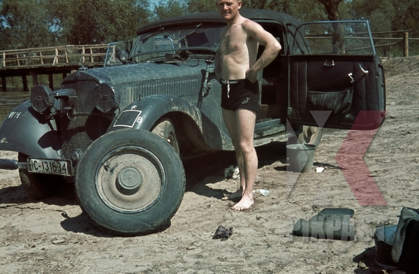 stock-photo-german-staff-driver-changing-flat-tyre-of-mercedes-230-w143-1941-russian-front-4th-panzer-division-ic131634-8588 (1).jpg