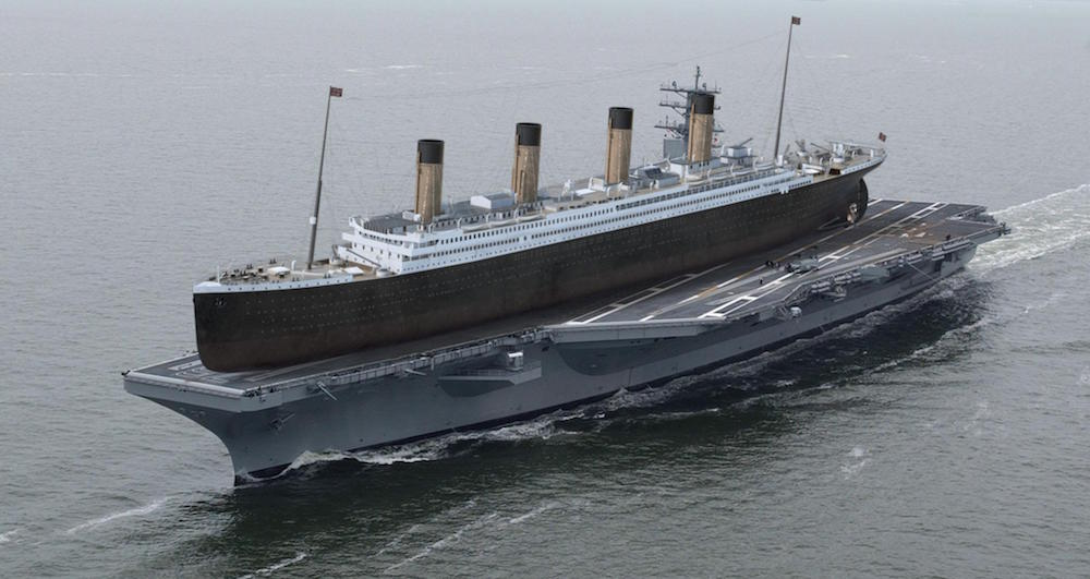 If the Titanic (882 ft) was placed on the deck of the U.S.S. Ronald Reagan, the ship would have 210