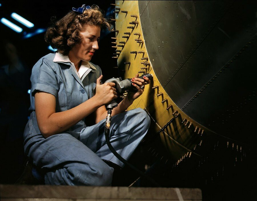 October 1942. Riveter at work on a bomber at the Consolidated Aircraft factory in Fort Worth.jpg