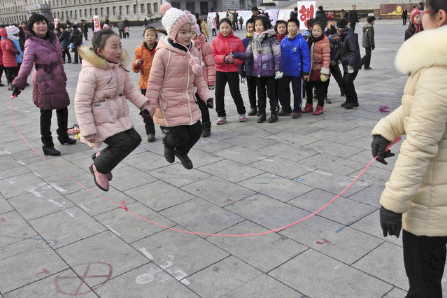 North Korean students skip rope as they gather at Kim Il Sung Square for Lunar New Year in Pyongyang
