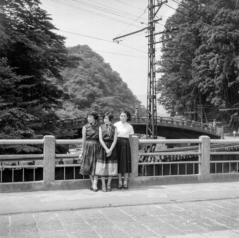 Three Women on a Bridge - 1950s Japan. Shinkyo bridge belonging to the Futarasan Shrine in the background