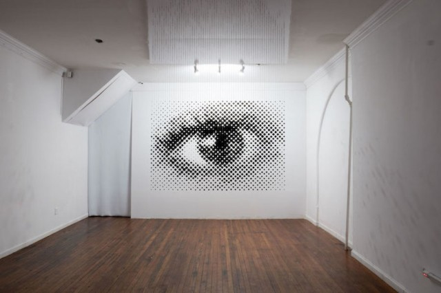 Eye Sculpture with 1252 Balls Playing on Anamorphosis