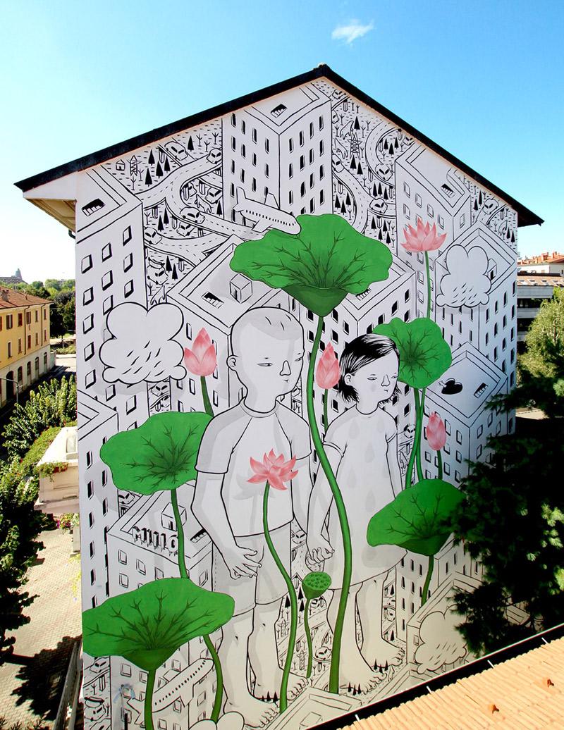 Artista explora o espaco urbano com seus afetuosos murais.