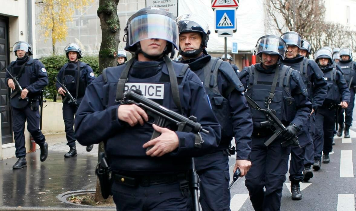 French intervention police take up position near the scene of a hostage taking at a kosher supermarket in eastern Paris
