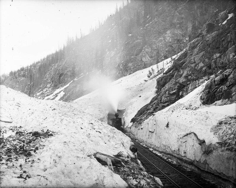 Denver & Rio Grande Railroad locomotive 327 emerging from south portal of Snowslide Tunnel in San Juan County, Colorado, 1909