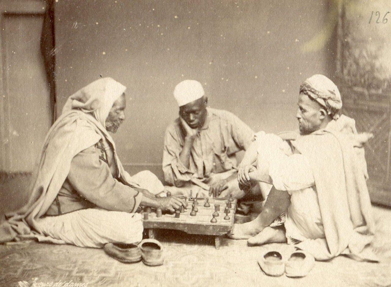 1875. Игра в шашки