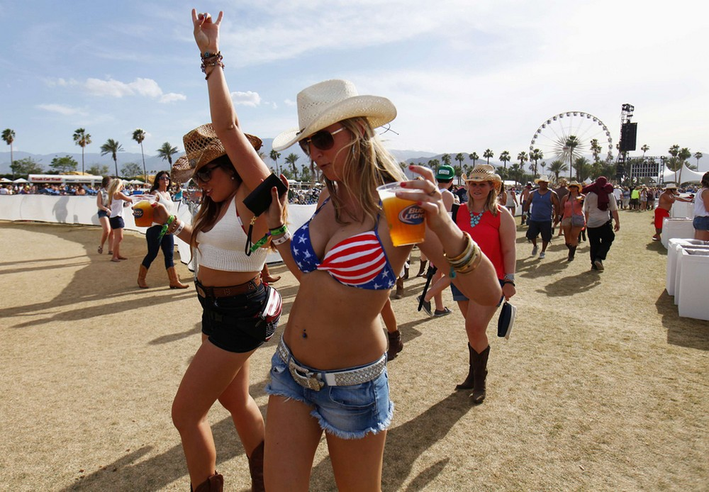 Country music fans arrive with drinks in hand during first day of Stagecoach country music festival in Indio