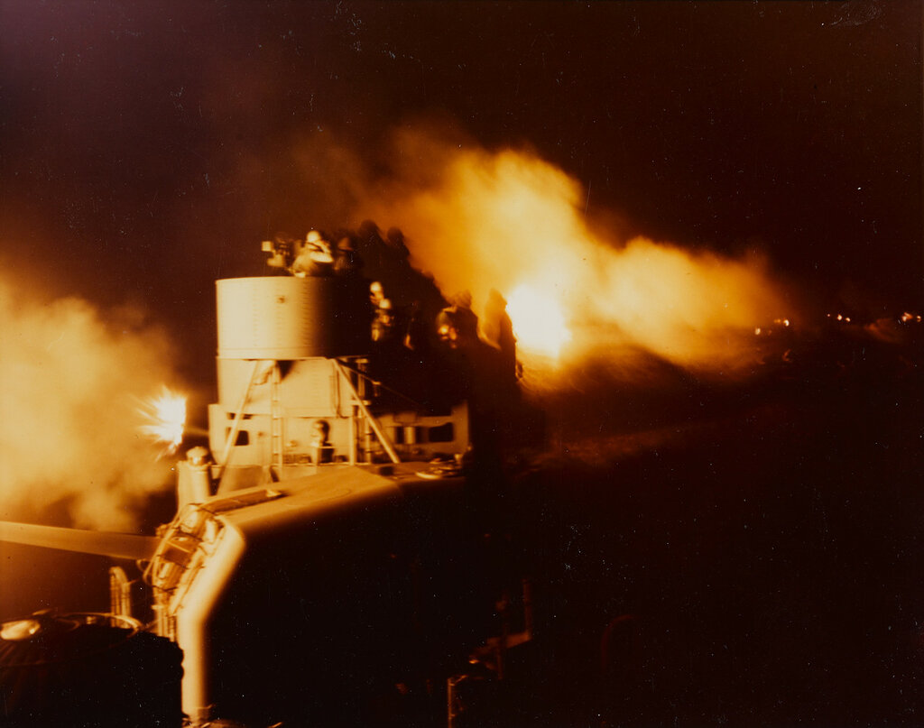 Munda-Vila Bombardment. Night firing by ships of task force 18 seen from USS NICHOLAS (DD-449) whose 5in/38 mount is in the foreground.Thu, May 13, 1943.