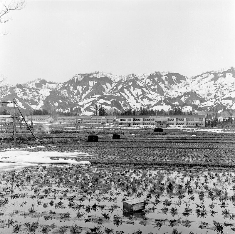 Fields, Factory & Snowy Mountains