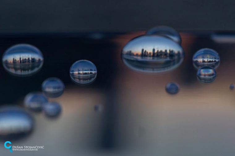 Capturing cities through water drops