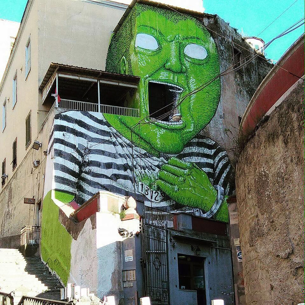 Street artist Blu was recently spotted in Naples, Italy putting the finishing touches on this giant