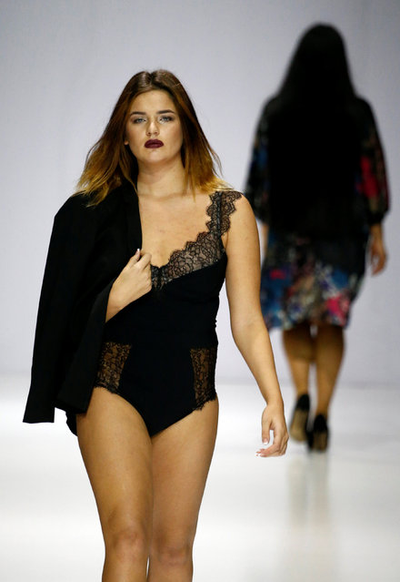 Models present creations as part of La Redoute plus size fashion boutique collection during the Mosc