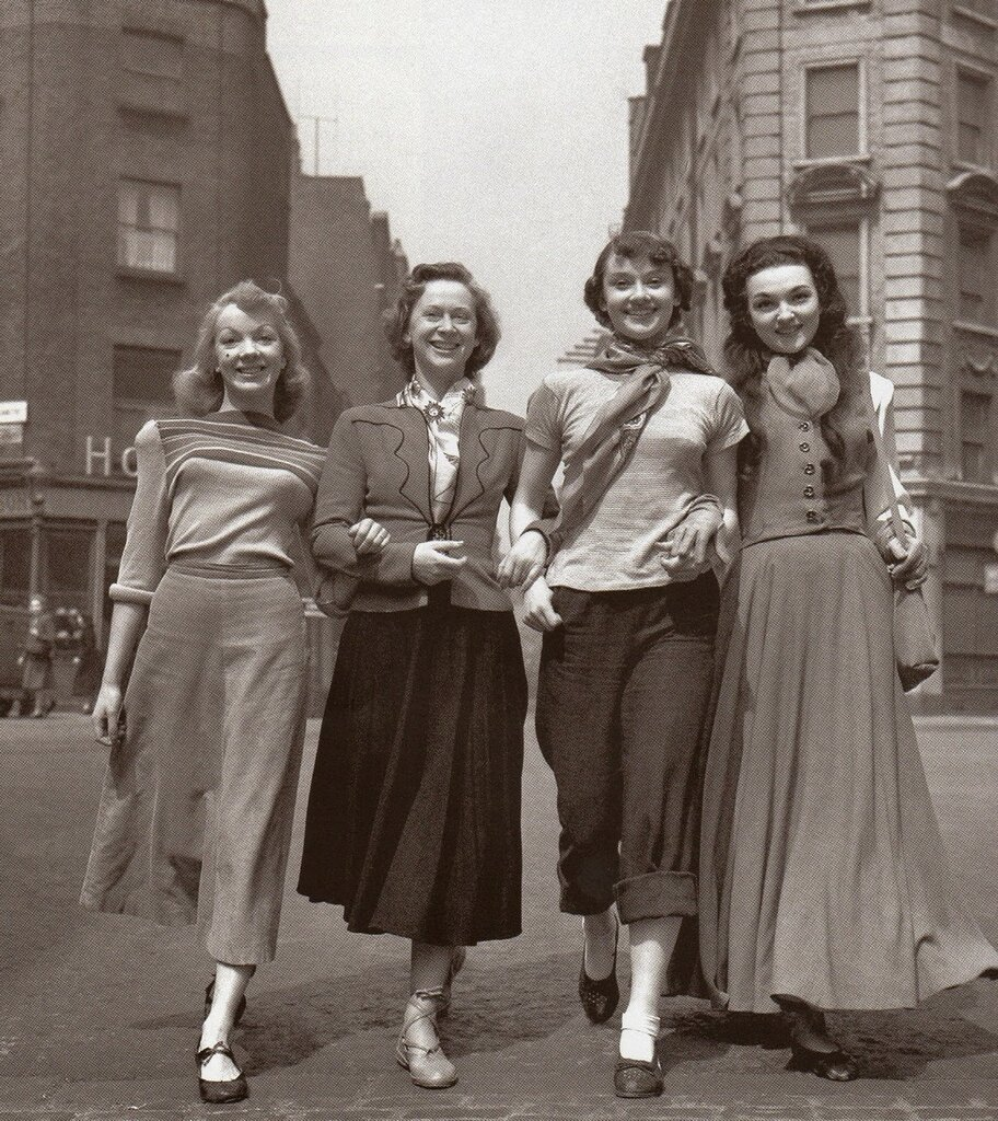 The girl members of the cast arrive at the Cambridge Theatre rehearsal of Sauce Tartare, 1949. Left to right - Aud Johannsen, Nina Tarakanova, Audrey Hepburn and Marlana.jpg