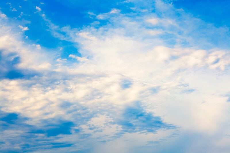 Blue sky with spindrift clouds, may be used as background.