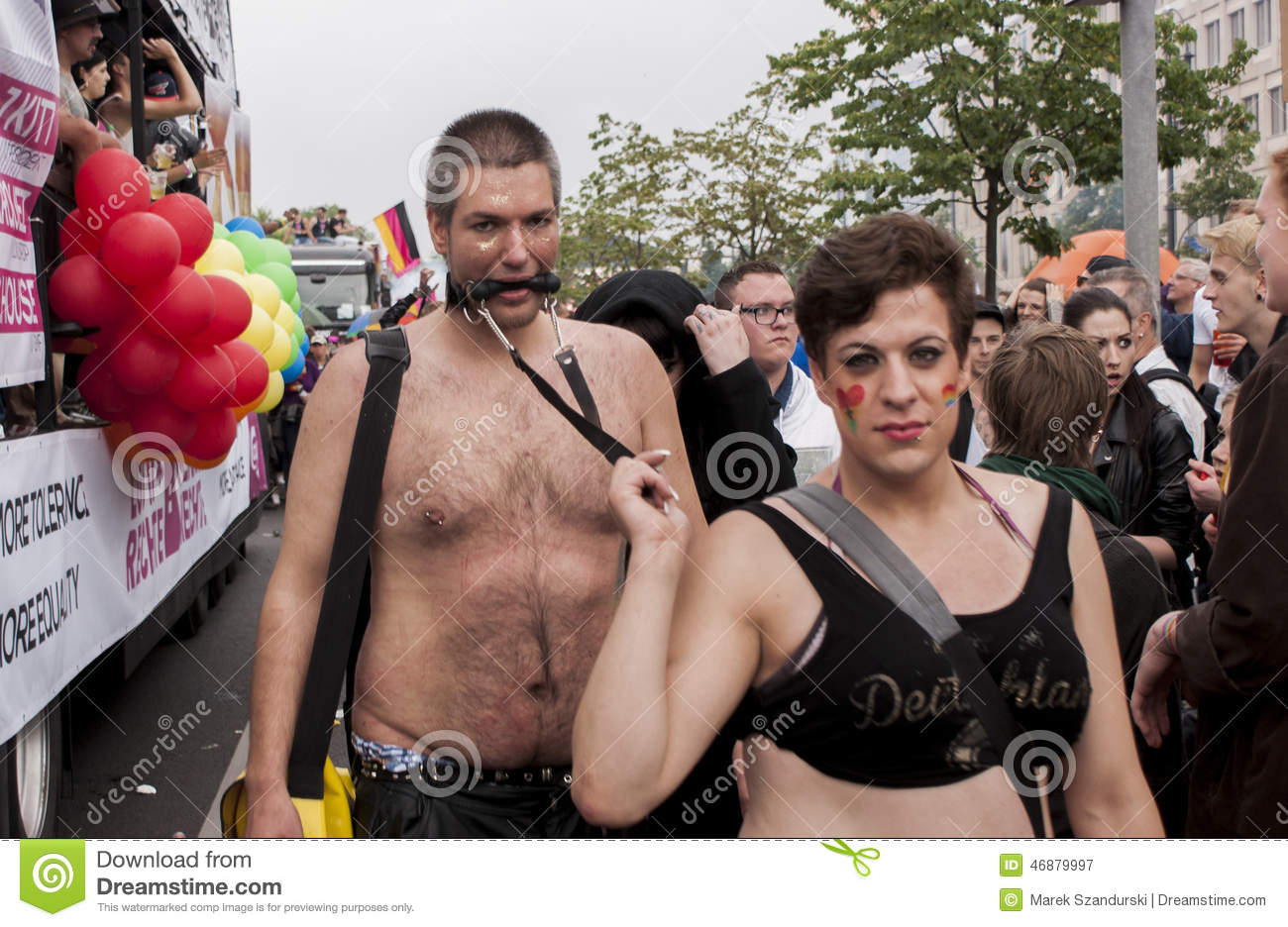 http://www.dreamstime.com/royalty-free-stock-photography-elaborately-dressed-couple-christopher-street-day-parade-berlin-germany-june-crowd-people-participate-celebrates-image46879997