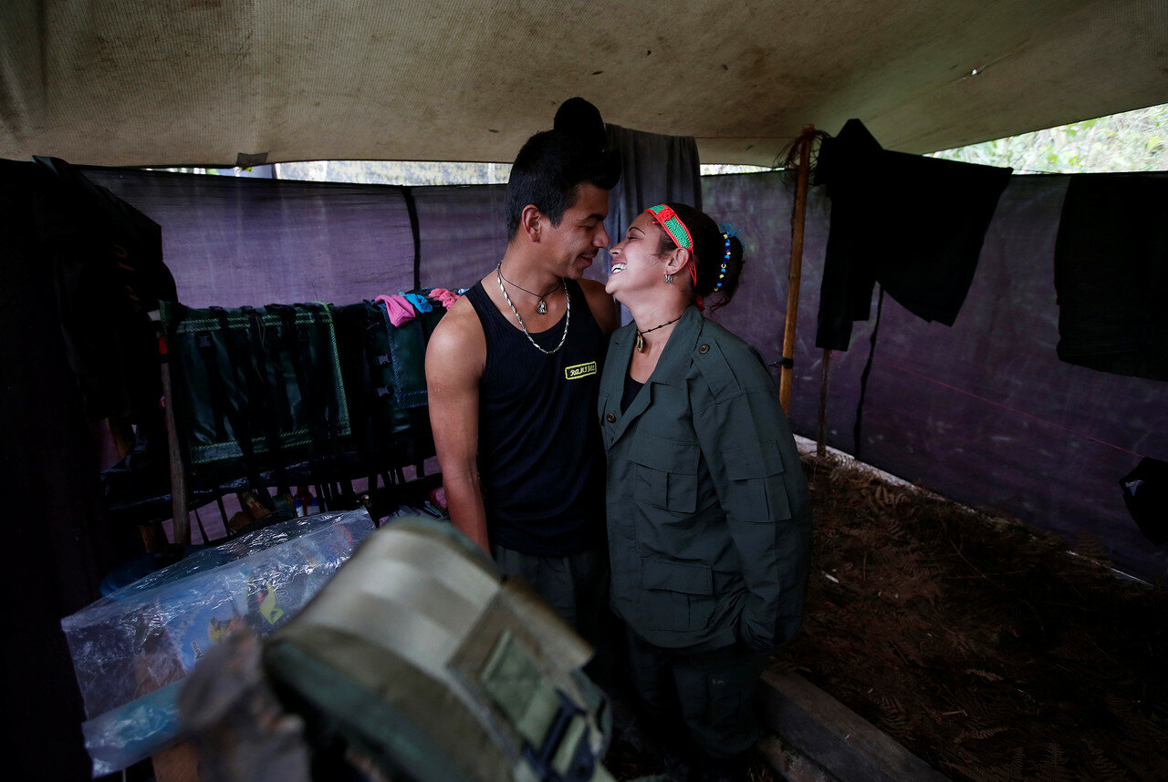 Yeimi and Sebastian, members of the 51st Front of the Revolutionary Armed Forces of Colombia (FARC), are seen inside a tent at a camp in Cordillera Oriental