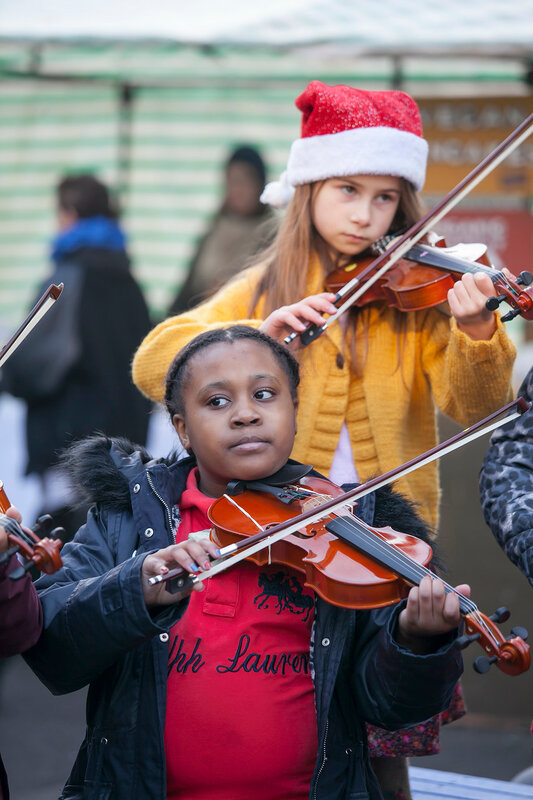 children play the violin at the Christmas Fair