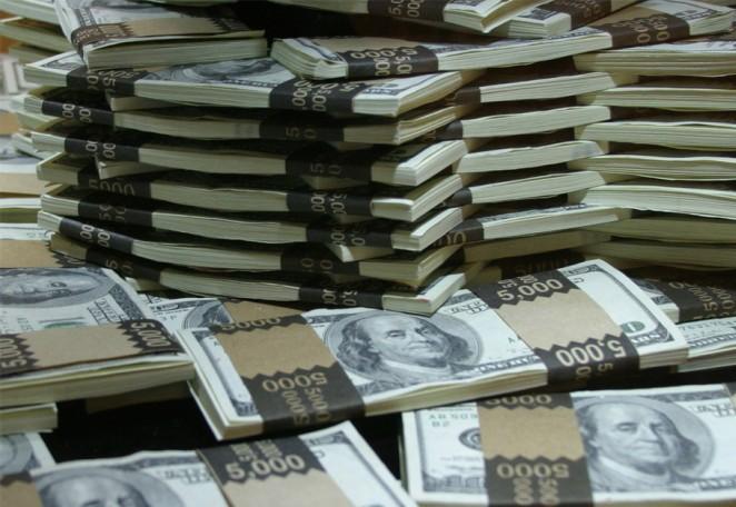 стопки денег доллары