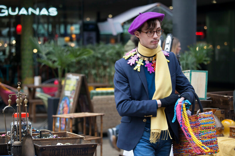 Brightly dressed man  in typical East London style on Brick Lane. Street fashion.