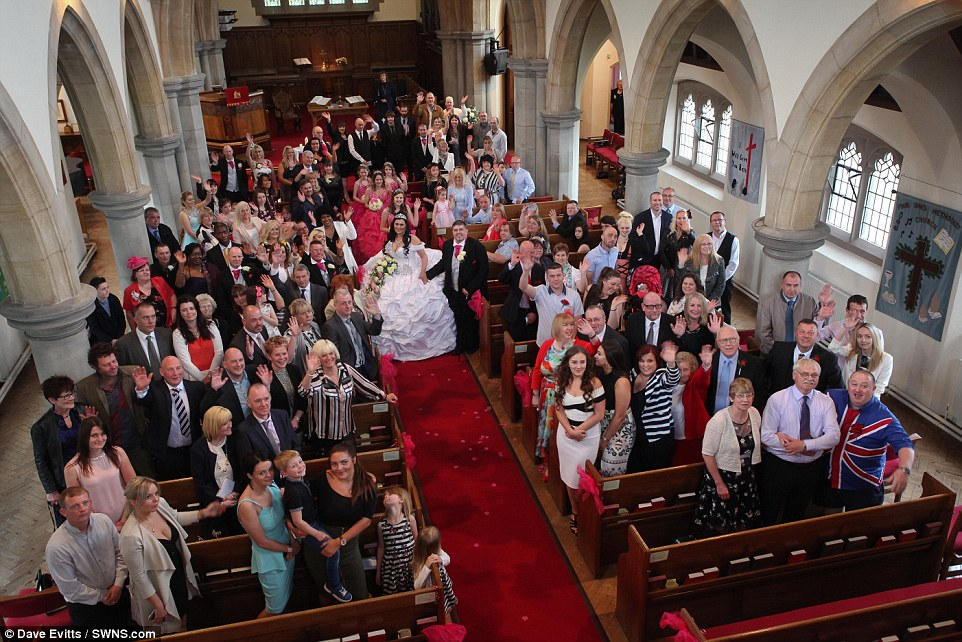 Общая фотография с гостями и родными в церкви.