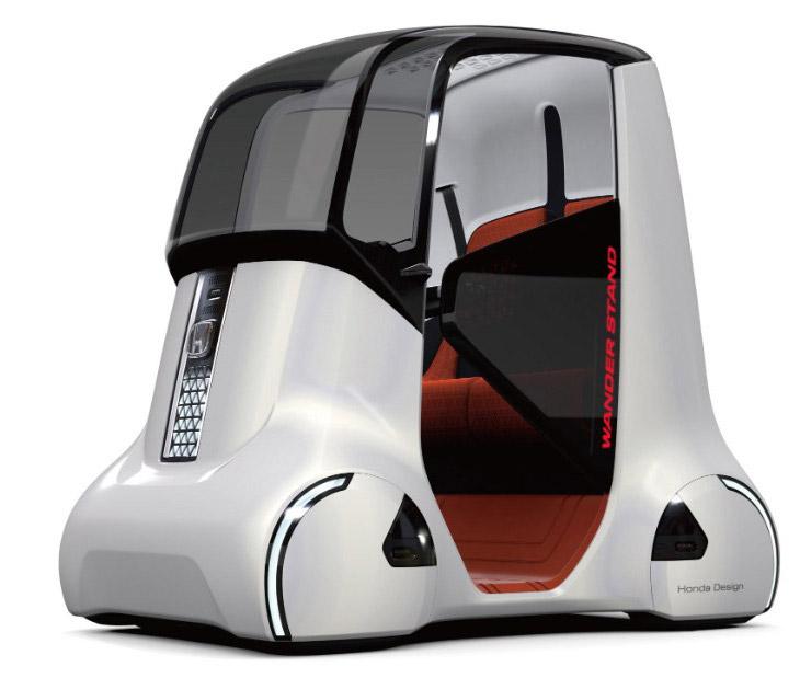 2. Еще один продукт от Хонды — Wander Walker . Это высокотехнологичный скутер с деревянной отделкой,