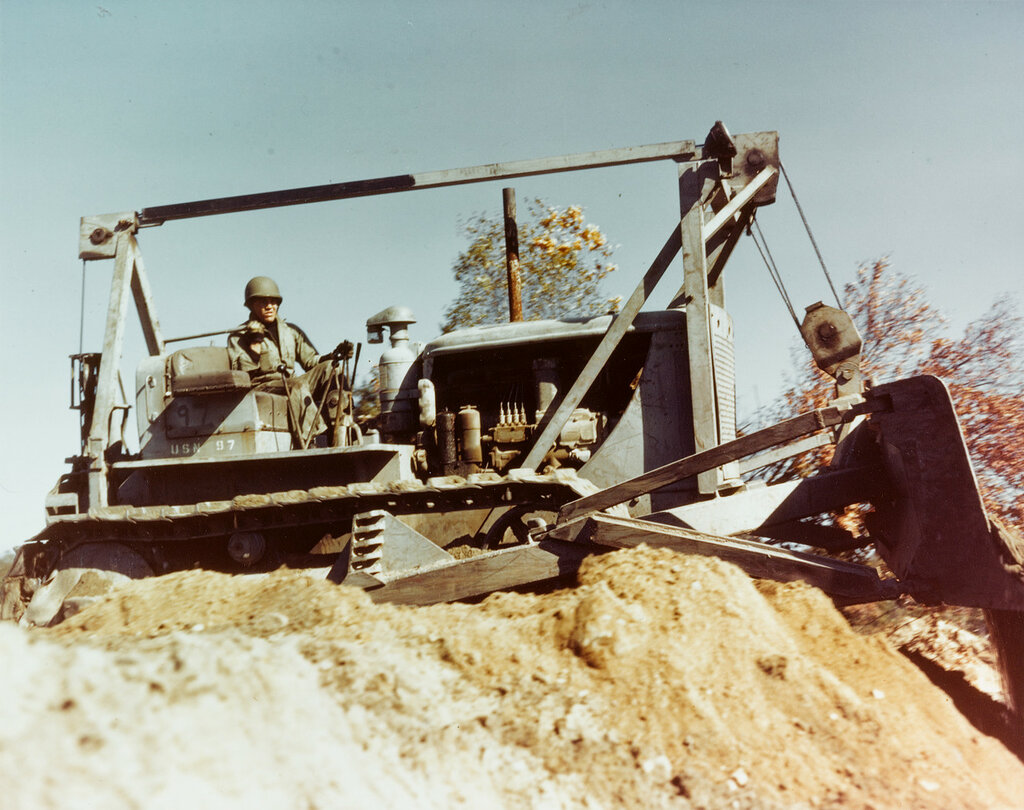 """""""Seabee"""" Bulldozer. Moving the earth, at the construction Battalion Training Center, Camp Endicott, Davisville, R.I., in the fall of 1943."""