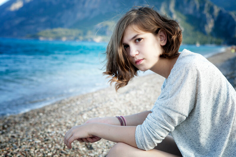 serious thoughtful girl in  sitting on the beach