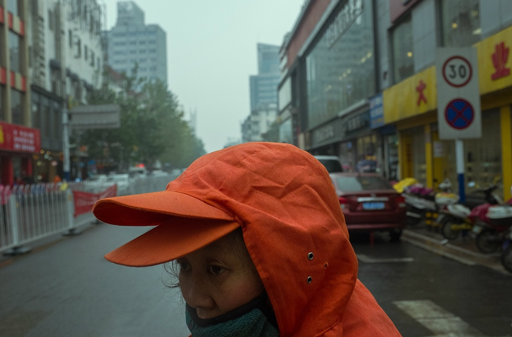 Uncanny Moments on the Streets of China Photographed by Water Meter Reader Tao Liu