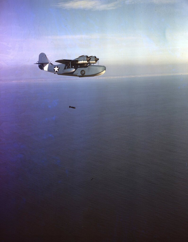 U. S. Coast Guard Grumman JRF-2 Goose in flight and dropping a depth charge, probably over Long Island, N.Y. ca. 1943.