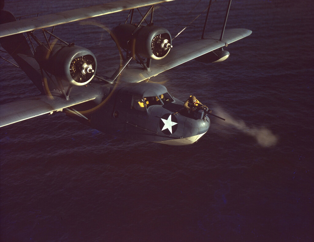 U. S. Coast Guard Hall PH-3 in flight, off the Long Island coastline, the bow gunner is firing his weapon, ca. 1943.