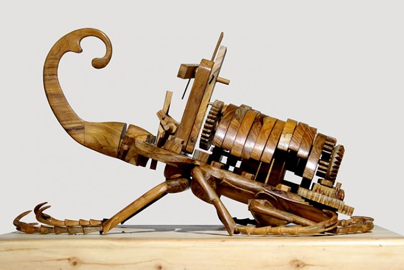 Nyanyian Kumbang Tanduk , 2015. 100 x 80 x 150 cm. Jati Wood, Electric Motor, Ultrasonic Sensor.