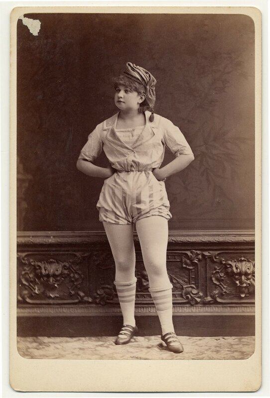1890. Unidentified female performer [Camille?]in short sailor-style costume, shoes with knee-high stockings.