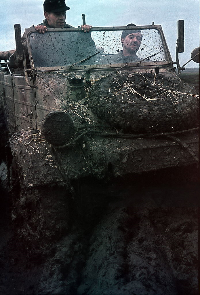 German soldiers in a jeep on muddy terrain in the Ukraine spring 1942 - Photographer Wolff & Tritschle.jpg